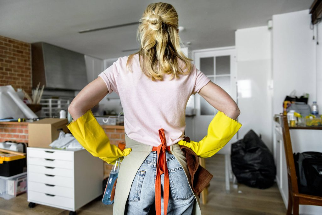 A woman getting ready to clean