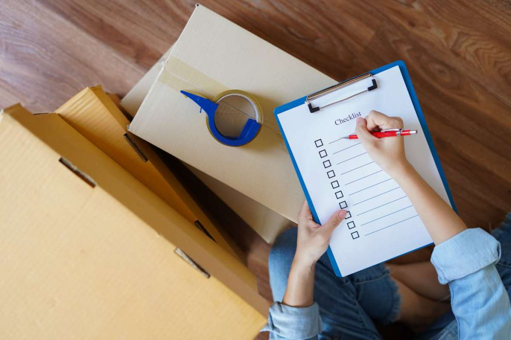 A woman getting ready to fill up her checklist before hiring local movers in Dallas, TX