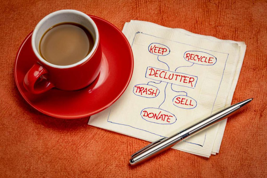 A cup of coffee and a napkin with decluttering options